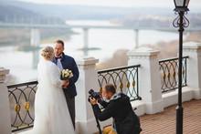 Wedding Photographer Taking Pi...