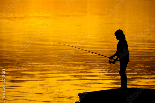 Young Child Kid Person Fishing in Lake or River Sunset Canvas Print