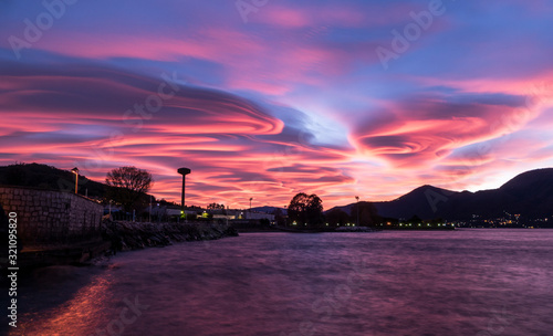 Sunset with spiral clouds over the lake Maggiore Canvas-taulu