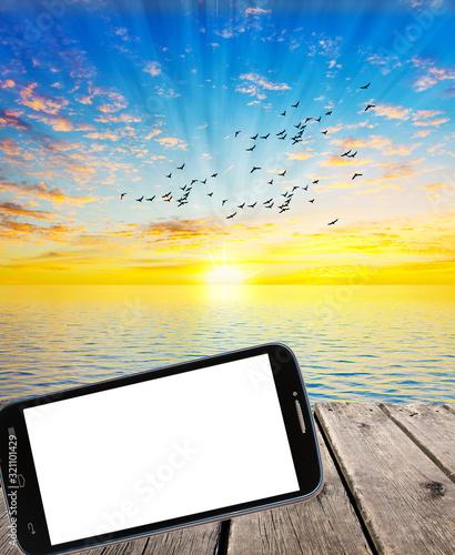 fotografia de un atardecer con un telefono para poner anuncios Canvas Print