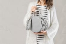 Stylish Fashionable Woman With Grey Round Bag