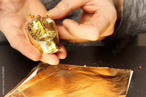Artwork of gilding - covering an object with plate metal gold Wallpaper Mural