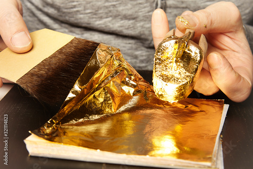 Artwork of gilding - covering an object with plate metal gold Canvas Print