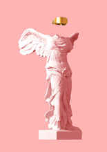 3D Model Of Winged Victory With Golden VR Glasses On Pink Background
