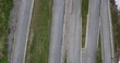 Aerial view of people walking and motorcycles moving on winding road, Tremola Road, Switzerland