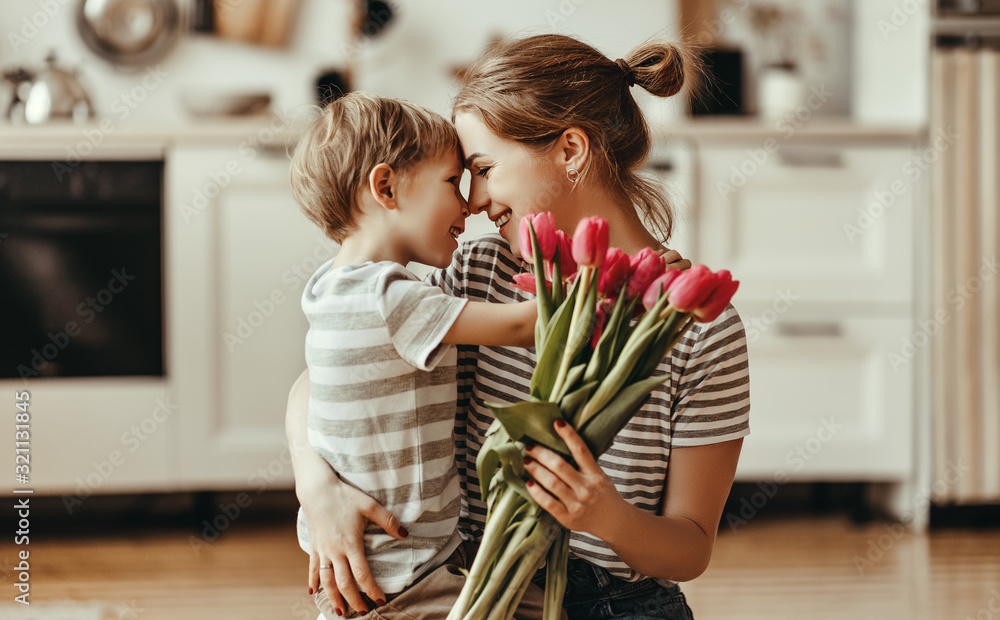 Fototapeta happy mother's day! child son gives flowers for  mother on holiday .