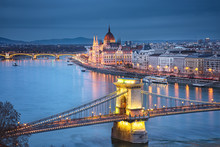 Famous Chain Bridge With The Hungarian Parliament In The Background
