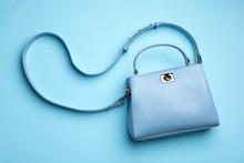 Stylish Woman's Bag On Light Blue Background, Top View
