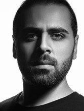 Vertical Black And White Head Shot Of Middle Eastern Guy On White Background