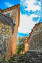 Narrow Staircase Made Of Stones In The Village Of Deia In Mallorca, Spain