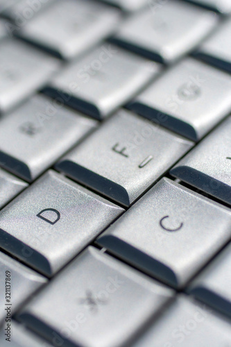 Silver keyboard on an old laptop Canvas Print
