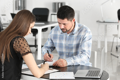 Couple signing a loan contract in bank Canvas Print