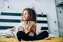 Smiling Child Using Smartphone...