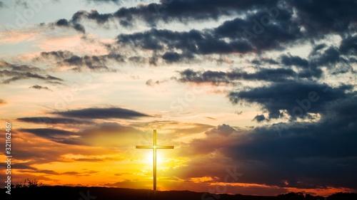 Christian cross on sunset background Wallpaper Mural