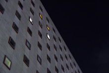 Concrete Building With Several Lights On At Night
