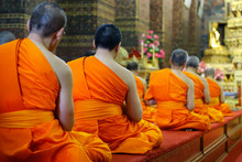 Heads Of Monk Praying In Buddhist Temple
