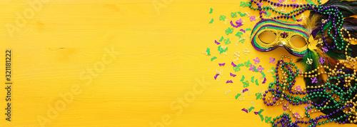Fotomural Holidays image of mardi gras masquarade venetian mask over yellow background