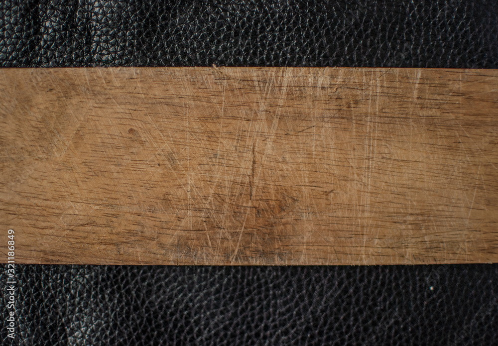 Fototapeta The black leather with wooden panels background texture