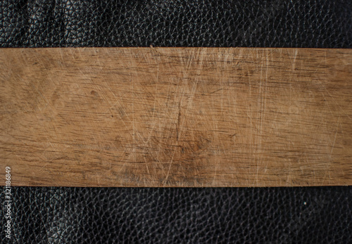 The black leather with wooden panels background texture