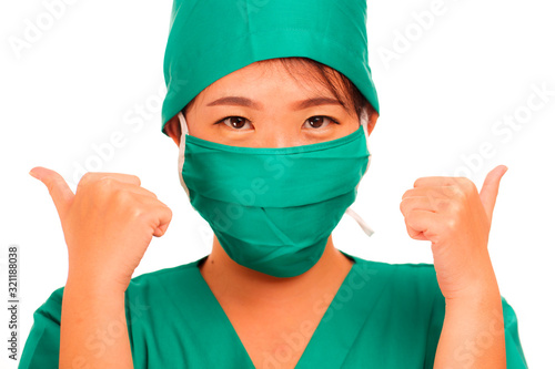 Photo young beautiful and happy Asian Chinese medicine doctor woman or hospital nurse
