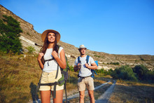 Couple Hikers With Backpack On...