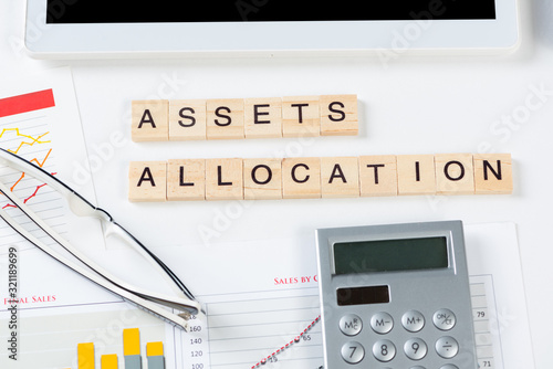 Photo Asset allocation concept with letters on cubes