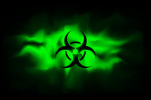 Biohazard Sign On A Background Of Infected Green Fog. Spreading Smoke Attack Biological Weapons. Dangerous Haze Poisoned. Vector Illustration