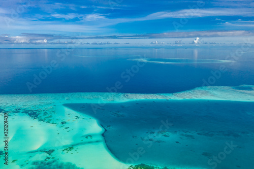 Tropical islands and atolls in Maldives from aerial view Wallpaper Mural