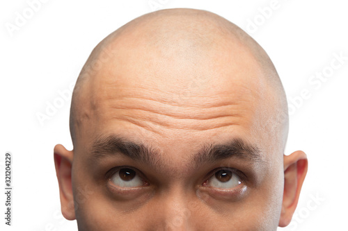 Fotografiet Photo of shaved man looking up, half head