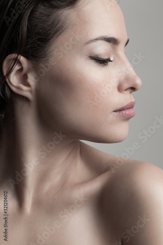 Obraz natural beauty concept young woman  profile  face closeup studio shot - fototapety do salonu