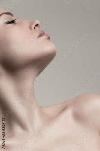 Fototapeta natural beauty concept young woman  profile  face and neck studio shot obraz