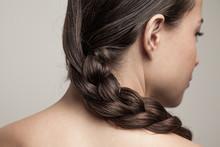 Closeup Of Wet Woman Hair In Braid Studio Shot Rear View Focus On Hair