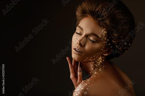 Fotografie, Obraz Fashion art portrait of model girl with holiday golden shiny professional makeup