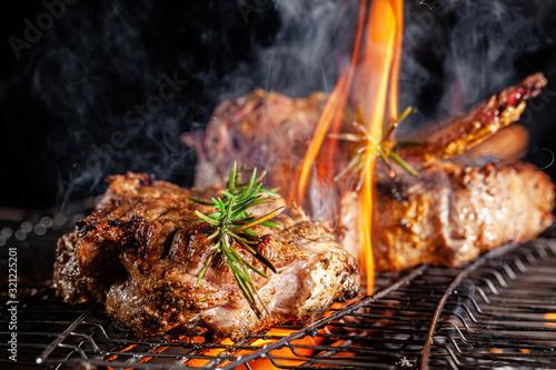Chef cook fries meat, beef steak on an open fire in a restaurant Wallpaper Mural