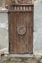Atique Vintage Back Door Made And Decorated With Weathered Wood Logs.