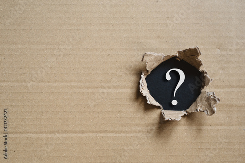 Stampa su Tela Torned corrugated box revealing question mark