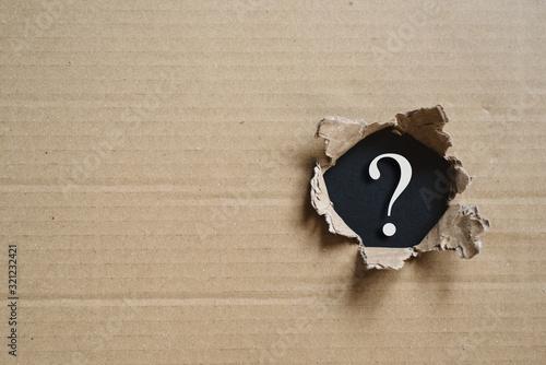 Fotografie, Tablou Torned corrugated box revealing question mark