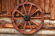 Cart Wheel On The Wall Of A Wo...