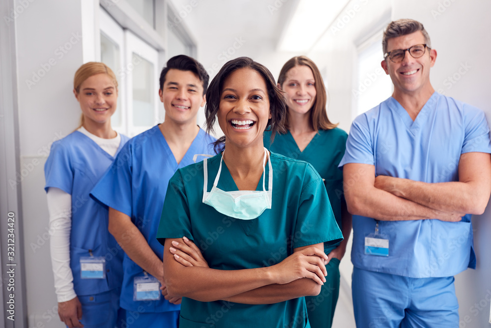 Fototapeta Portrait Of Laughing Multi-Cultural Medical Team Standing In Hospital Corridor