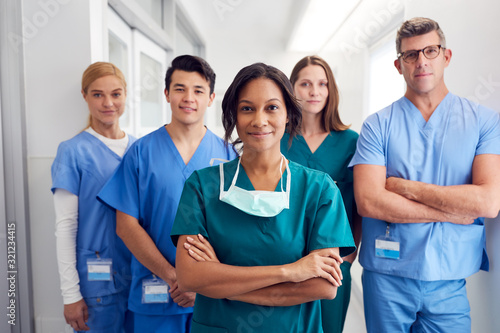 Obraz Portrait Of Multi-Cultural Medical Team Standing In Hospital Corridor - fototapety do salonu