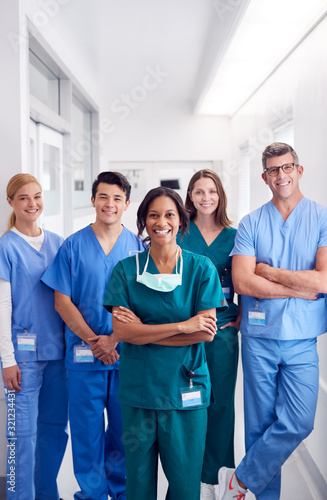 Fototapeta Portrait Of Smiling Multi-Cultural Medical Team Standing In Hospital Corridor obraz