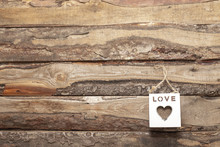 Valentine's Day Love Heart Shaped White Cube Decoration On Rustic Style Wooden Background With Copy Space. Holiday Card For Valentine's Day.