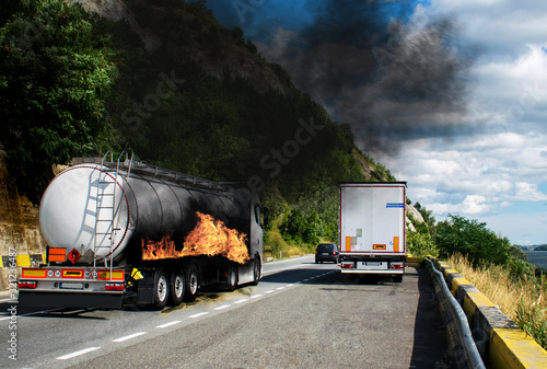 a large white truck carrying flammable substances Poster Mural XXL
