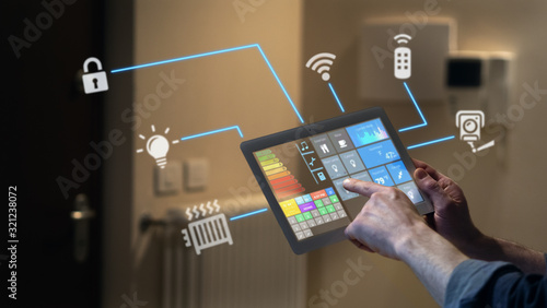 Close up of a man hand is using a futuristic latest innovative technology glass tablet with augmented reality holograms as a remote control of smart home appliances at home or office Wallpaper Mural