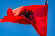 Red Albanian Flag Flying In Th...