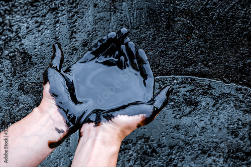 Fototapeta crude oil surface background textured. Pollution with oil products. obraz