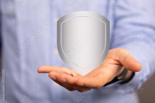 Fototapeta cyber shield protection concept holding in hand obraz