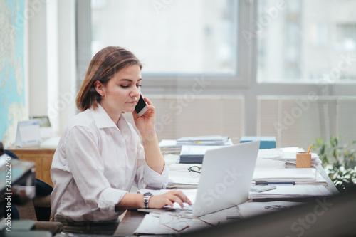 Fototapeta Woman in office working, reading a document obraz na płótnie