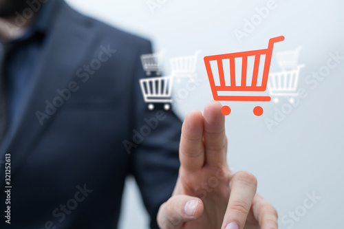 Fototapeta Shopping cart as part of the network in hand . The concept of Innovation in e-Commerce. obraz