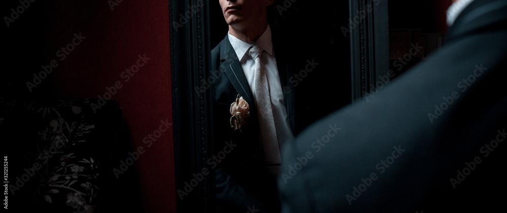Fototapeta Elegant man clothing of a groom in a mirror reflection in dark